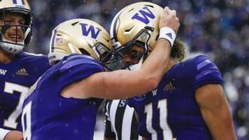 Sep 18, 2021; Seattle, Washington, USA; Washington Huskies quarterback Dylan Morris (9) and wide   Joe Nicholson-USA TODAY Sports