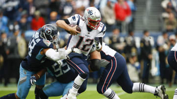 NASHVILLE, TN - NOVEMBER 11: Tom Brady #12 of the New England Patriots escapes a tackle by Harold Landry #58 of the Tennessee Titans during the third quarter at Nissan Stadium on November 11, 2018 in Nashville, Tennessee. (Photo by Wesley Hitt/Getty Images)