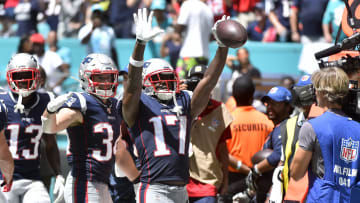 MIAMI, FL - SEPTEMBER 15: Antonio Brown #17 of the New England Patriots  celebrates after catching a touchdown in the second quarter of the game against the Miami Dolphins at Hard Rock Stadium on September 15, 2019 in Miami, Florida. (Photo by Eric Espada/Getty Images)