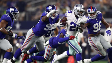 ARLINGTON, TX - SEPTEMBER 16:  Ezekiel Elliott #21 of the Dallas Cowboys runs the ball against the New York Giants at AT&T Stadium on September 16, 2018 in Arlington, Texas.  (Photo by Ronald Martinez/Getty Images)