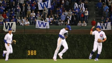 """CHICAGO, ILLINOIS - JUNE 20: Fans hold up """"W"""" flags after the Chicago Cubs beat the New York Mets at Wrigley Field on June 20, 2019 in Chicago, Illinois. The Cubs defeated the Mets 7-4. (Photo by Jonathan Daniel/Getty Images)"""