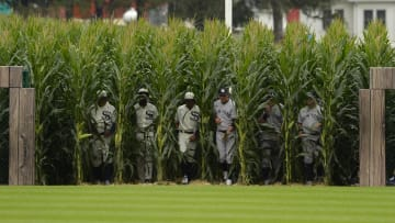 Yankees and White Sox emerge from the field of corn onto the Field of Dreams.