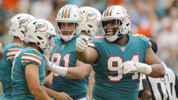 Miami Dolphins defensive lineman Christian Wilkins (right)