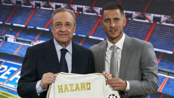 Eden Hazard's (R) transfer to Real Madrid is announced alongside the club's president Florentino Pérez (L)