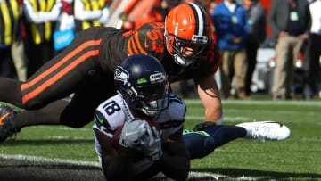 CLEVELAND, OHIO - OCTOBER 13: Jaron Brown #18 of the Seattle Seahawks catches a third quarter touchdown in front of Joe Schobert #53 of the Cleveland Browns at FirstEnergy Stadium on October 13, 2019 in Cleveland, Ohio. (Photo by Gregory Shamus/Getty Images)