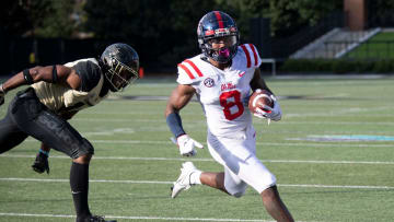 Mississippi wide receiver Elijah Moore (8) drives into the end zone for a touchdown past Vanderbilt
