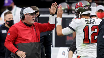 Tom Brady giving a high five to Bruce Arians.