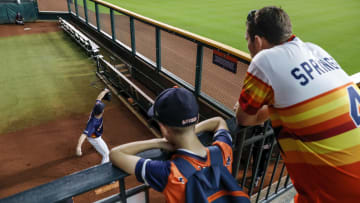 HOUSTON, TX - AUGUST 29:  Fans watch as Justin Verlander #35 of the Houston Astros throws a bullpen session before the game against the Tampa Bay Rays at Minute Maid Park on August 29, 2019 in Houston, Texas.  (Photo by Tim Warner/Getty Images)
