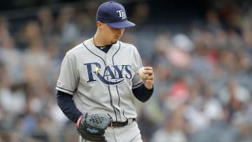 NEW YORK, NEW YORK - JUNE 19:   Blake Snell #4 of the Tampa Bay Rays looks at the ball as he stands on the mound during the first inning against the New York Yankees at Yankee Stadium on June 19, 2019 in New York City. (Photo by Jim McIsaac/Getty Images)