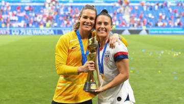 Ashlyn Harris and Ali Krieger with the 2019 World Cup trophy