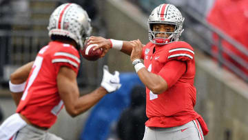 COLUMBUS, OH - OCTOBER 26:  Quarterback Justin Fields #1 of the Ohio State Buckeyes throws against the Wisconsin Badgers at Ohio Stadium on October 26, 2019 in Columbus, Ohio.  (Photo by Jamie Sabau/Getty Images)