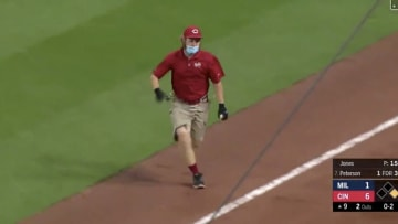 Cincinnati Reds ballboy takes a spill during the game.