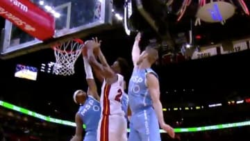 Miami Heat guard Jimmy Butler gets blocked by 3 Minnesota Timberwolves