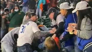 Fans fight in the stands of a Giants-Dodgers game at Oracle Park