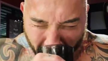 Dave Bautista drinking water.