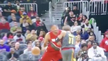 Portland Trailblazers' Trevor Ariza checks Atlanta Hawks' Trae Young on nutmeg attempt