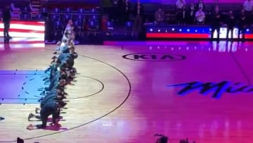 The Boston Celtics and Miami Heat kneel for the national anthem before their game.