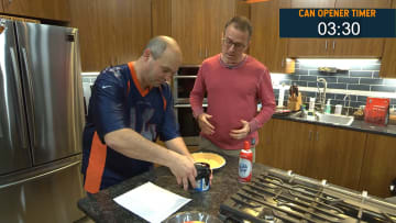 Todd Fritz struggles with a can opener for five minutes while Paul Pabst looks on