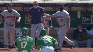 Houston Astros hitting coach Alex Cintron challenges A's outfielder Ramon Laureano to a fight