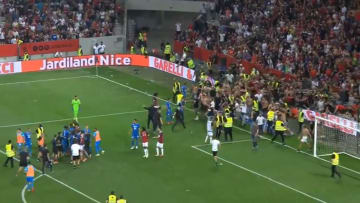 Nice fans storm the pitch in huge brawl