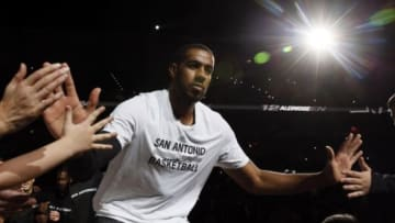 Dec 5, 2015; San Antonio, TX, USA; San Antonio Spurs power forward LaMarcus Aldridge (12) greets the fans during player introductions before the game against the Boston Celtics at AT&T Center. Mandatory Credit: Soobum Im-USA TODAY Sports