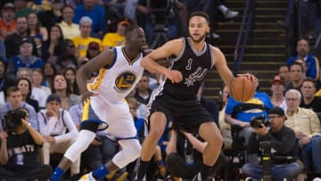 April 7, 2016; Oakland, CA, USA; San Antonio Spurs forward Kyle Anderson (1) dribbles the basketball against Golden State Warriors forward Draymond Green (23) during the fourth quarter at Oracle Arena. The Warriors defeated the Spurs 112-101. Mandatory Credit: Kyle Terada-USA TODAY Sports