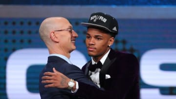 Jun 23, 2016; New York, NY, USA; Dejounte Murray (Washington) greets NBA commissioner Adam Silver after being selected as the number twenty-nine overall pick to the San Antonio Spurs in the first round of the 2016 NBA Draft at Barclays Center. Mandatory Credit: Jerry Lai-USA TODAY Sports