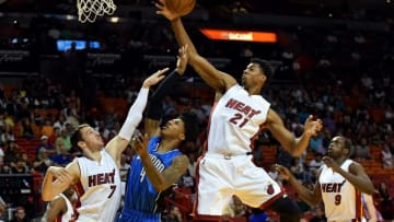 Apr 10, 2016; Miami, FL, USA; Miami Heat center Hassan Whiteside (right) blocks the basket from Orlando Magic guard Elfrid Payton (center) as Miami Heat guard Goran Dragic (left) defends the play during the first half at American Airlines Arena. Mandatory Credit: Steve Mitchell-USA TODAY Sports