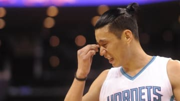 Apr 29, 2016; Charlotte, NC, USA; Charlotte Hornets guard Jeremy Lin (7) reacts after a hard hit during the first half in game six of the first round of the NBA Playoffs against the Miami Heat at Time Warner Cable Arena. Mandatory Credit: Sam Sharpe-USA TODAY Sports