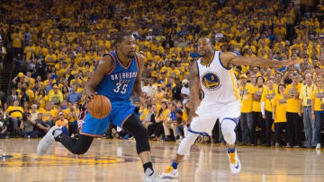 May 30, 2016; Oakland, CA, USA; Oklahoma City Thunder forward Kevin Durant (35) dribbles the basketball against Golden State Warriors forward Andre Iguodala (9) during the fourth quarter in game seven of the Western conference finals of the NBA Playoffs at Oracle Arena. The Warriors defeated the Thunder 96-88. Mandatory Credit: Kyle Terada-USA TODAY Sports