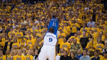 May 30, 2016; Oakland, CA, USA; Oklahoma City Thunder forward Kevin Durant (35) shoots the basketball against Golden State Warriors forward Andre Iguodala (9) during the fourth quarter in game seven of the Western conference finals of the NBA Playoffs at Oracle Arena. The Warriors defeated the Thunder 96-88. Mandatory Credit: Kyle Terada-USA TODAY Sports