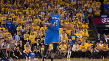 May 30, 2016; Oakland, CA, USA; Oklahoma City Thunder forward Kevin Durant (35) dribbles the basketball during the third quarter in game seven of the Western conference finals of the NBA Playoffs against the Golden State Warriors at Oracle Arena. The Warriors defeated the Thunder 96-88. Mandatory Credit: Kyle Terada-USA TODAY Sports