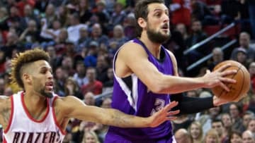 Jan 26, 2016; Portland, OR, USA; Sacramento Kings guard Marco Belinelli (3) drives past Portland Trail Blazers guard Allen Crabbe (23) during the first quarter at the Moda Center. Mandatory Credit: Craig Mitchelldyer-USA TODAY Sports