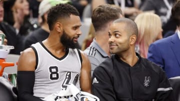Oct 29, 2016; San Antonio, TX, USA; San Antonio Spurs point guard Patty Mills (8) and Tony Parker (9, right) talk on the bench during the second half against the New Orleans Pelicans at AT&T Center. Mandatory Credit: Soobum Im-USA TODAY Sports
