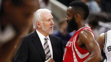 Oct 23, 2015; San Antonio, TX, USA; Houston Rockets shooting guard James Harden (R) talks to San Antonio Spurs head coach Gregg Popovich (L) during the first half at AT&T Center. Mandatory Credit: Soobum Im-USA TODAY Sports
