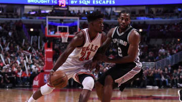 Dec 8, 2016; Chicago, IL, USA; Chicago Bulls forward Jimmy Butler (21) dribbles the ball against San Antonio Spurs forward Kawhi Leonard (2) during the second half at the United Center. Chicago defeated San Antonio 95-91. Mandatory Credit: Mike DiNovo-USA TODAY Sports