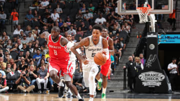 SAN ANTONIO, TX - OCTOBER 7: Dejounte Murray #5 of the San Antonio Spurs handles the ball against the Houston Rockets on October 7, 2018 at AT&T Center, in San Antonio, Texas. NOTE TO USER: User expressly acknowledges and agrees that, by downloading and/or using this Photograph, user is consenting to the terms and conditions of the Getty Images License Agreement. Mandatory Copyright Notice: Copyright 2018 NBAE (Photo by Nathaniel S. Butler/NBAE via Getty Images)
