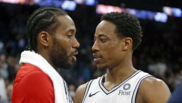 SAN ANTONIO, TX - JANUARY 3: DeMar DeRozan #10 of the San Antonio Spurs greets Kawhi Leonard #2 of the Toronto Raptors at the end of the game at AT&T Center on January 3, 2019 in San Antonio, Texas. NOTE TO USER: User expressly acknowledges and agrees that , by downloading and or using this photograph, User is consenting to the terms and conditions of the Getty Images License Agreement. (Photo by Ronald Cortes/Getty Images)