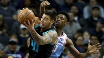 CHARLOTTE, NORTH CAROLINA - JANUARY 17: Willy Hernangomez #41 of the Charlotte Hornets battles for a loose ball against Harry Giles #20 of the Sacramento Kings during their game at Spectrum Center on January 17, 2019 in Charlotte, North Carolina. NOTE TO USER: User expressly acknowledges and agrees that, by downloading and or using this photograph, User is consenting to the terms and conditions of the Getty Images License Agreement. (Photo by Streeter Lecka/Getty Images)