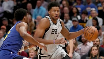 DENVER, COLORADO - APRIL 23: Rudy Gay #22 of the San Antonio Spurs drives against Malik Beasley #25 of the Denver Nuggets (Photo by Matthew Stockman/Getty Images)