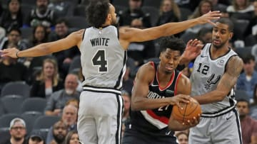 SAN ANTONIO, TX - NOVEMBER 16: Hassan Whiteside #21 of the Portland Trail Blazers is defended by Derrick White #4 and LaMarcus Aldridge #12 of the San Antonio Spurs in the first half at AT&T Center on November 16, 2019 in San Antonio, Texas. NOTE TO USER: User expressly acknowledges and agrees that, by downloading and or using this photograph, User is consenting to the terms and conditions of the Getty Images License Agreement. (Photo by Ronald Cortes/Getty Images)