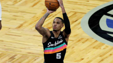 ORLANDO, FL - APRIL 12: Dejounte Murray #5 of the San Antonio Spurs shoots the ball against the Orlando Magic at Amway Center on April 12, 2021 in Orlando, Florida. NOTE TO USER: User expressly acknowledges and agrees that, by downloading and or using this photograph, User is consenting to the terms and conditions of the Getty Images License Agreement. (Photo by Alex Menendez/Getty Images)
