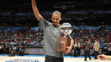 ORLANDO, FL - FEBRUARY 25: Tony Parker #9 of the San Antonio Spurs with his trophy after winning the Taco Bell Skills Challenge as part of 2012 All-Star Weekend at the Amway Center on February 25, 2012 in Orlando, Florida. NOTE TO USER: User expressly acknowledges and agrees that, by downloading and/or using this photograph, user is consenting to the terms and conditions of the Getty Images License Agreement. Mandatory Copyright Notice: Copyright 2012 NBAE (Photo by Nathaniel S. Butler/NBAE via Getty Images)