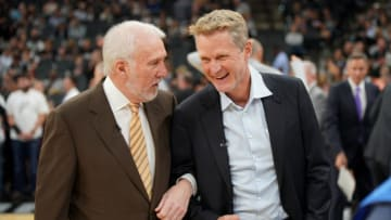 SAN ANTONIO, TX - NOVEMBER 2: Head Coaches Gregg Popovich of the San Antonio Spurs and Steve Kerr of the Golden State Warriors talk before the game on November 2, 2017 at the AT&T Center in San Antonio, Texas. NOTE TO USER: User expressly acknowledges and agrees that, by downloading and or using this photograph, User is consenting to the terms and conditions of the Getty Images License Agreement. Mandatory Copyright Notice: Copyright 2017 NBAE (Photo by Darren Carroll/NBAE via Getty Images)