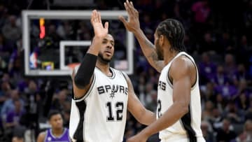 SACRAMENTO, CA - OCTOBER 27: Kawhi Leonard #2 of the San Antonio Spurs is congratulated by LaMarcus Aldridge #12 after Leonard scored a basket against the Sacramento Kings during the second quarter of an NBA basketball game at Golden 1 Center on October 27, 2016 in Sacramento, California. NOTE TO USER: User expressly acknowledges and agrees that, by downloading and or using this photograph, User is consenting to the terms and conditions of the Getty Images License Agreement. (Photo by Thearon W. Henderson/Getty Images)