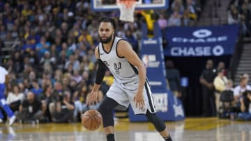 OAKLAND, CA - FEBRUARY 10: Patty Mills #8 of the San Antonio Spurs dribbles the ball against the Golden State Warriors during an NBA basketball game at ORACLE Arena on February 10, 2018 in Oakland, California. NOTE TO USER: User expressly acknowledges and agrees that, by downloading and or using this photograph, User is consenting to the terms and conditions of the Getty Images License Agreement. (Photo by Thearon W. Henderson/Getty Images)