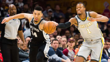 CLEVELAND, OH - FEBRUARY 25: Danny Green #14 of the San Antonio Spurs fights Rodney Hood #1 of the Cleveland Cavaliers for a loose ball during the first half at Quicken Loans Arena on February 25, 2018 in Cleveland, Ohio. NOTE TO USER: User expressly acknowledges and agrees that, by downloading and or using this photograph, User is consenting to the terms and conditions of the Getty Images License Agreement. (Photo by Jason Miller/Getty Images)