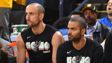 OAKLAND, CA - APRIL 24: Tony Parker #9 and Manu Ginobili #20 of the San Antonio Spurs looks on during the game against the Golden State Warriors in Game Five of Round One of the 2018 NBA Playoffs on April 24, 2018 at ORACLE Arena in Oakland, California. NOTE TO USER: User expressly acknowledges and agrees that, by downloading and or using this photograph, user is consenting to the terms and conditions of Getty Images License Agreement. Mandatory Copyright Notice: Copyright 2018 NBAE (Photo by Andrew D. Bernstein/NBAE via Getty Images)