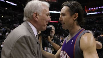 SAN ANTONIO - MAY 09: Guard Steve Nash #13 of the Phoenix Suns talks with head coach Gregg Popovich of the San Antonio Spurs in Game Four of the Western Conference Semifinals during the 2010 NBA Playoffs at AT&T Center on May 9, 2010 in San Antonio, Texas. The Suns defeated the Spurs 107-101 and win the series 4-0. NOTE TO USER: User expressly acknowledges and agrees that, by downloading and or using this photograph, User is consenting to the terms and conditions of the Getty Images License Agreement. (Photo by Ronald Martinez/Getty Images)