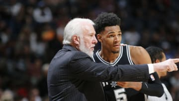 SAN ANTONIO, TX - APRIL 1: Head Coach Gregg Popovich of the San Antonio Spurs talks with Dejounte Murray #5 of the San Antonio Spurs during the game against the Houston Rockets on April 1, 2018 at the AT&T Center in San Antonio, Texas. NOTE TO USER: User expressly acknowledges and agrees that, by downloading and or using this photograph, user is consenting to the terms and conditions of the Getty Images License Agreement. Mandatory Copyright Notice: Copyright 2018 NBAE (Photos by Chris Covatta/NBAE via Getty Images)